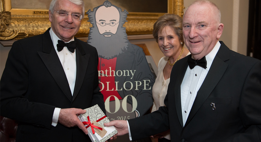 Michael Williamson presents Sir John Majopr with a copy of Barchester Towers